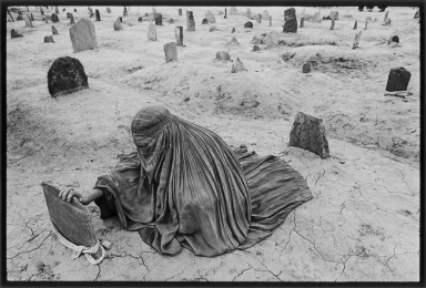 Afghanistan, 1996 - Mourning a brother killed by a Taliban rocket.