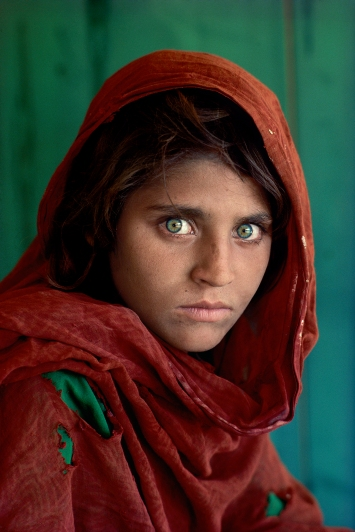 """CAPTION: Sharbat Gula, Afghan Girl. Peshawar, Pakistan, 1984. MAX PRINT SIZE: 40x60' Sharbat Gula, at Nasir Bagh refugee camp near Peshawar, Pakistan, 1984 -Untold (pg. 81) National Geographic Magazine, Vol. 167, No. 6, June 1985, Along Afghanistan's War-torn Frontier. """"The green-eyed Afghan girl became a symbol in the late twentieth century of strength in the face of hardship. Her tattered robe and dirt-smudged face have summoned compassion from around the world; and her beauty has been unforgettable. The clear, strong green of her eyes encouraged a bridge between her world and the West. And likely more than any other image, hers has served as an international emblem for the difficult era and a troubled nation."""" - Phaidon 55 The iconic image does not stand outside of time. Rather, it connects with the moment in a deeply profound way. Such as images are imbued with meaning, a significance that resonates deeply with a wide and diverse audience. McCurry's photograph of the Afghan girl is one such image. For many, this beautiful girl dressed in a ragged robe became a worldwide symbol for a nation in a state of collapse. Haunted eyes tell of an Afghan refugee's fears. -- Bannon, Anthony. (2005). Steve McCurry. New York: Phaidon Press Inc., 12. NYC5958, MCS1985002 K035 Afghan Girl: Found National Geographic, April 2002 Phaidon, Iconic Images, final book_iconic, page 33. National Geographic Magazine, Along Afghanistan's War-torn Frontier, June 1985, Vol. 167, No. 6 Afghan girl, Pakistan, 1984 (Looking East, pg. 28) South Southeast_Book In the Shadow of Mountains_Book Steve Mccurry_Book Looking East_Book Iconic_Book Untold_book PORTRAITS_APP final print_MACRO final print_Sao Paulo final print_Milan final print_Birmingham Fine Art Print final print_HERMITAGE final print_Zurich final print_Ankara Retouched_ Sonny Fabbri 03/04/2015"""
