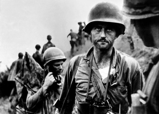 "US Marine Capt. Francis ""Ike"" Fenton glowering in despair as he is told that his company is almost out of ammunition as they try to hold off a heavy counter-attack by North Korean forces in the Naktong River area."
